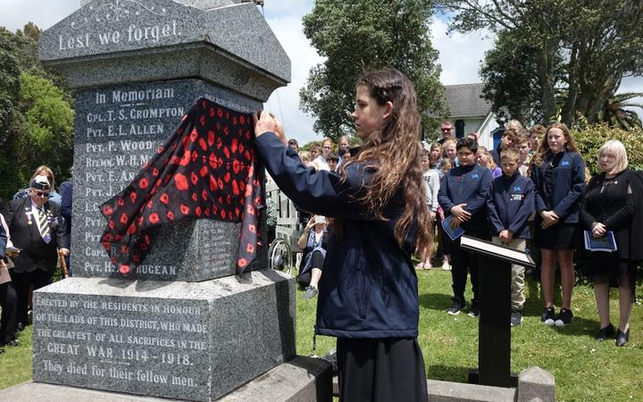 Charlotte Butler unveils WWI soldiers names on Omata memorial wall