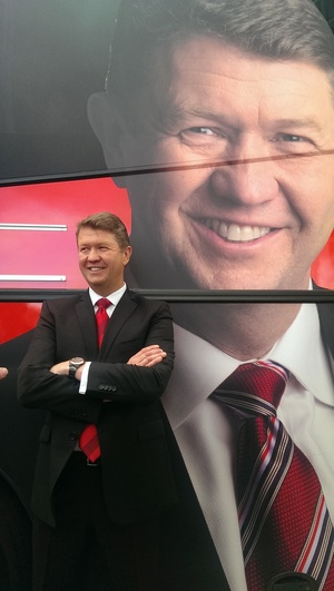 David Cunliffe standing in front of a campaign bus.