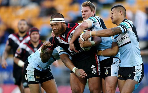 Manu Vatuvei grapples with Cronulla defenders at Mount Smart, August 2014.