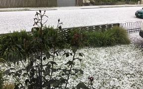 Hail covers the road on a Timaru street.