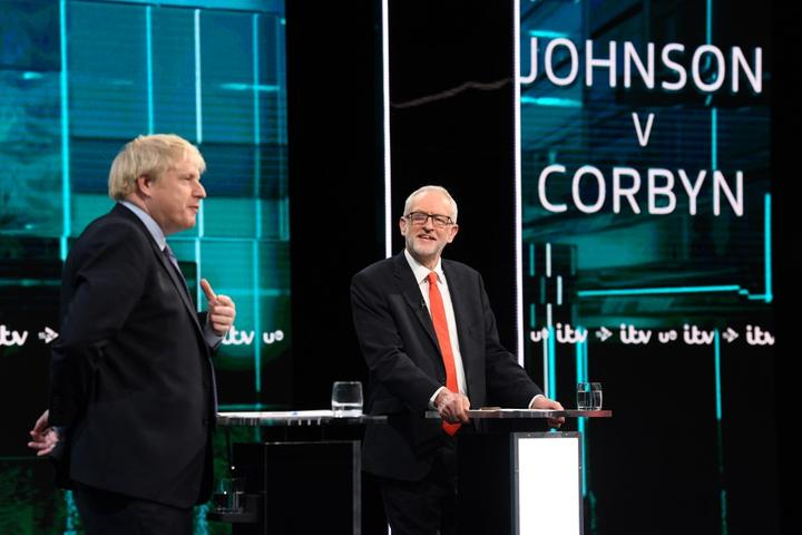 "Britain's Prime Minister Boris Johnson (L) and Britain's Labour Party leader Jeremy Corbyn (R) as they debate on the set of ""Johnson v Corbyn: The ITV Debate"" in Salford, north-west England. - Britain will go to the polls on December 12, 2019 to vote in a pre-Christmas general election."