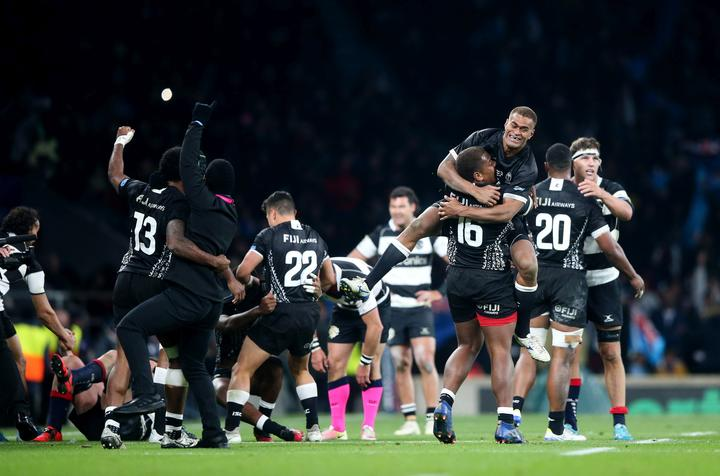 Fiji celebrate beating the Barbarians.