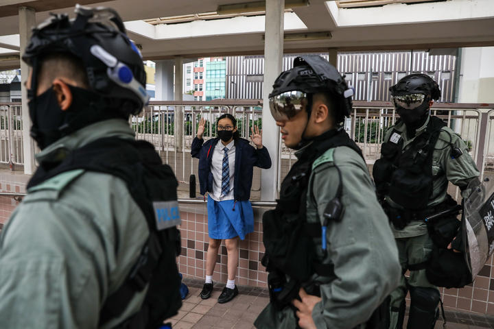 A school student is questioned by police in the Sai Wan Ho district in Hong Kong on November 12, 2019 following a day of pro-democracy protests.