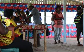 Voters file through a polling booth in Buka town to cast their vote for the Bougainville independence referendum.