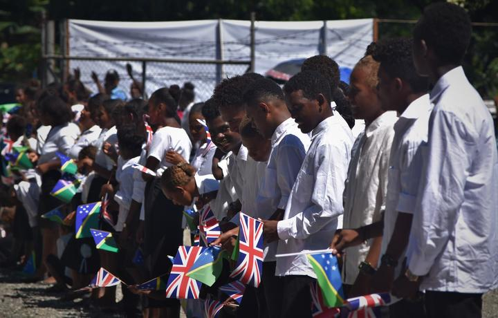 Students lined up to welcome the Prince of Wales in the Solomon Islands capital Honiara.