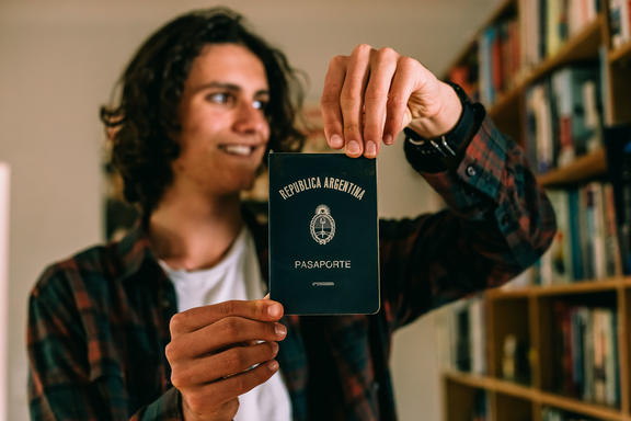 Felix Blaha showing his Father's Argentinian passport.