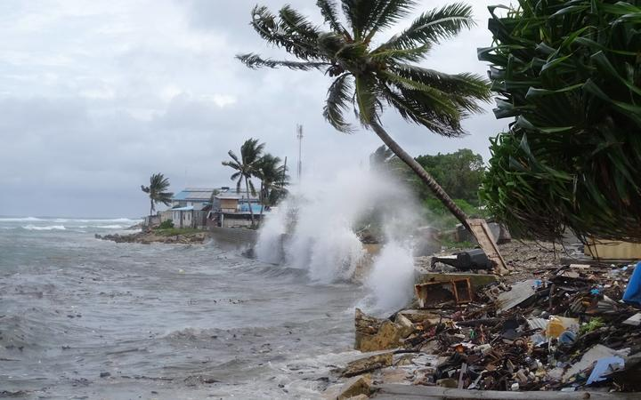 Waves crash into the Uliga back road sea wall in the Marshall Islands, 27-11-19.