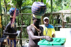 Young Upe men casting their votes in the Bougainville Referendum.