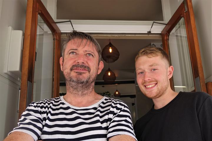 Cafe owner Gary Warner and Callum Webb who is on a working holiday from the UK.