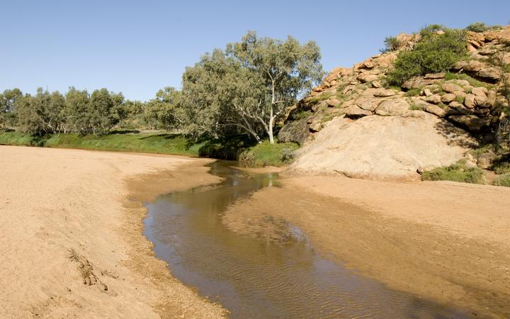 The surviving pool in the normally dry riverbed thought to be a spring from bedrock so was named Alice Springs in the town of the same name Alice Springs Northern Territory Australia Pacific