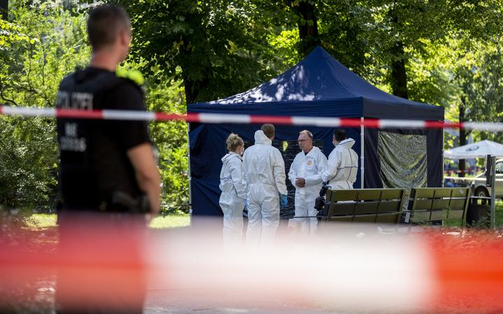 Police at Berlin's Kleiner Tiergarten park on 23 August 2019 where the Chechen exile was shot dead.