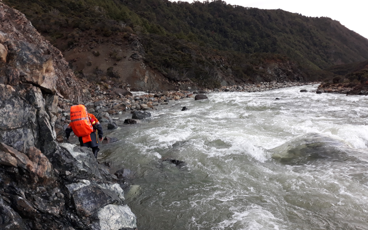 A search and rescue volunteer preparing to cross the Motueka River to reach an American hiker in November 2019.