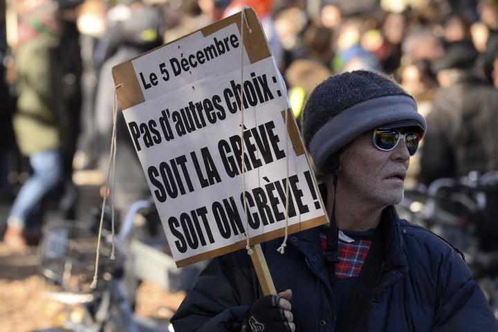 "A man holds a placard reading ""No choice: the strike or the death"" during a demonstration against the pension overhauls, in Bordeaux, on December 5, 2019, as part of a national general strike."