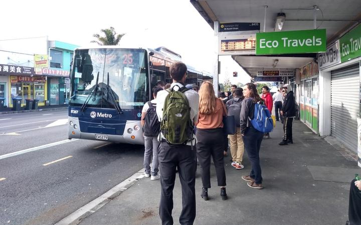 Commuters take a replacement bus service on Dominion Road. NZ Bus services are cancelled due to the industrial dispute.
