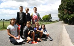 Tua Marina School students, from left, on bottom, Peyton Couper, Frank Brought, Quinn Verran, Jasmine Tierney, and above, Ethan Abbott, Henry Nott and Lucas Collins, asked the Marlborough District Council to reduce the 100kmh zone at their school.