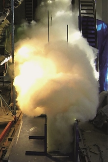 Front view of a pyroclastic flow ash and gas cloud surging down the eruption simulator.