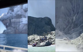 Images taken from a boat close to White Island shows a damaged helicopter and survivors of the eruption waiting to leave the island at the edge of the water.