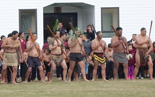 Tangata whenua welcoming police on to the marae.