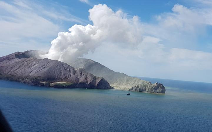 A view of Whakaari/White Island from the air as a helicopter approaches.