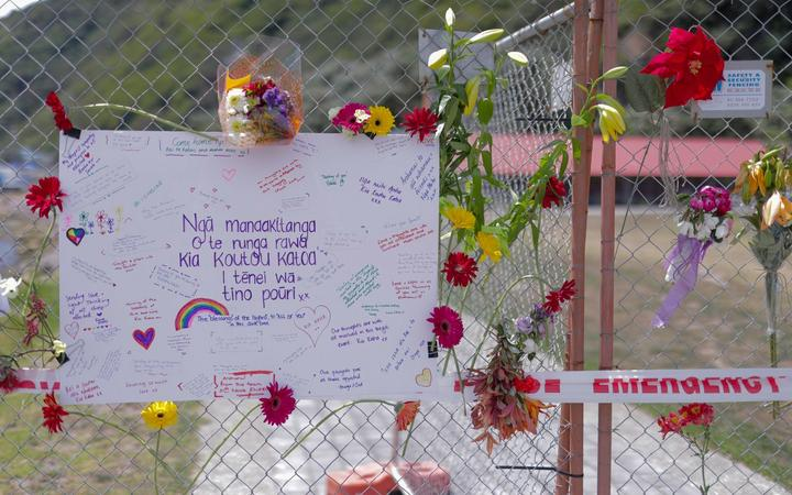 Flowers and messages at the cordon for the Whakaari/White Island eruption. 11.12.19