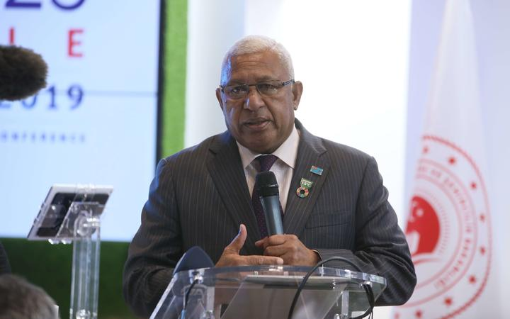 Fijian Prime Minister Frank Bainimarama makes a speech during a panel organised by UN-Habitat, within the United Nations Climate Change Conference.