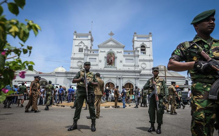 Sri Lankan military officers stand guard in front of St. Anthony's Church, where the blast occurred in Kochchide, Colombo, Sri Lanka.