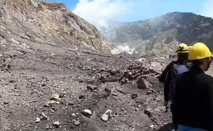 The group toured the island before finishing their trip and leaving on their boat. After they left they saw the eruption happening behind them.