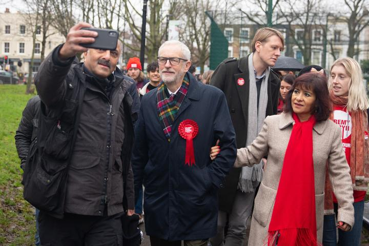 Labour Party Leader Jeremy Corbyn  and his wife Laura Alvez leave a polling station after voting.