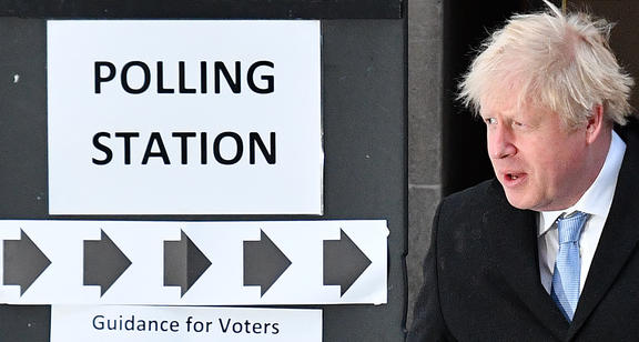 Boris Johnson leaves from a polling station after voting