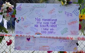 A card is pinned to a fence on the waterfront signed by locals with messages to those lost and injured by the White Island eruption on December the 9, in Whakatane, in Bay of Plenty on December 12, 2019.