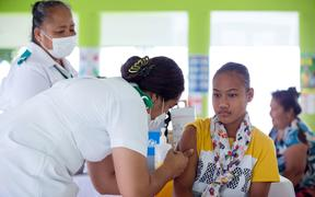 This picture released from UNICEF Samoa shows a girl receiving a vaccine during a nationwide campaign against measles in the Samoan town of Le'auva'a.