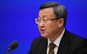 "Vice Minister of Commerce and Deputy International Trade Representative Wang Shouwen speaks during the State Council Information Office press conference in Beijing on December 13, after US President Donald Trump confirmed he was canceling new tariffs on China as part of a ""phase one"" trade deal."