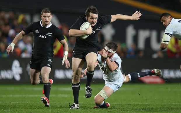 Ben Smith of the All Blacks breaks the tackle of Tom Wood of England during the third rugby test between the All Blacks and England in Hamilton. 2014.