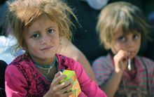 Several thousand from the the Yazidi community have crossed the Syrian-Iraqi border.