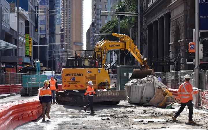 Workers are seen at the construction site of the 12 kilometer-long new light railway system in the central business district of Sydney on August 28, 2017. -