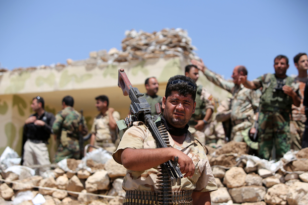 Iraqi Kurdish Peshmerga fighters in Bashiqa, north-east of Mosul, which has been taken by Islamic State militants.