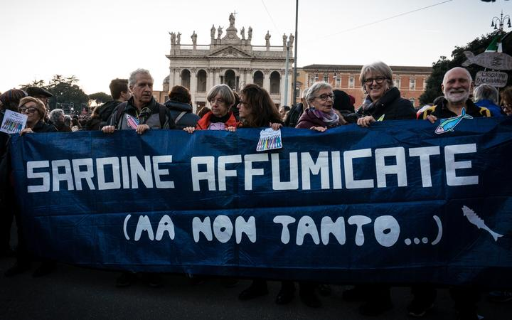 People gather in St. John at the Lateran Square for a demonstration of the Sardines  an Italian grass-roots movement against right-wing populism,  on December 14, 2019 in Rome