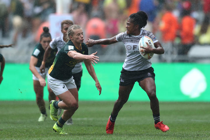 Fiji's Tokasa Seniyasi fends off the South Africa defence during the inaugural Cape Town Women's Sevens.
