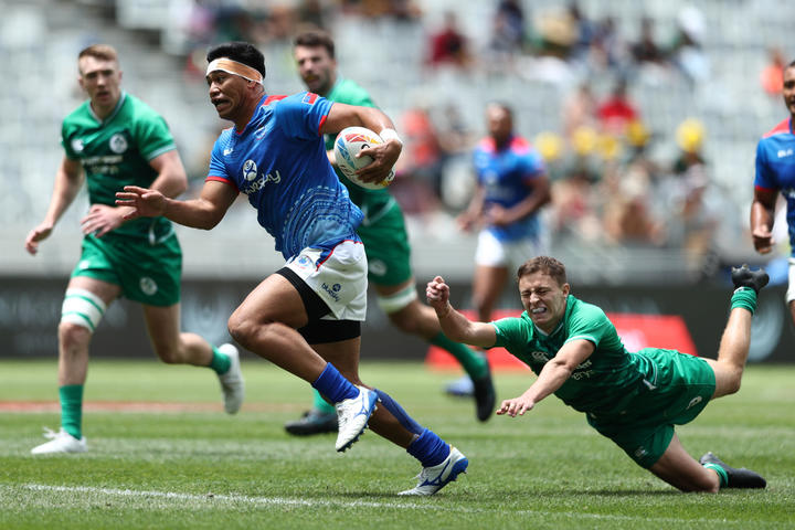 Samoa's Belgium Tuatagaloa breaks through the Ireland defence.