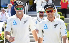 Trent Boult (right) playing against England in first test against Mount Maunganui in November.
