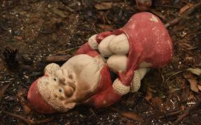 A scorched santa toy is seen on property razed by bushfires in Bargo, southwest of Sydney, on December 21, 2019.