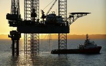 Dawn breaking over an oil drilling platform in Taranaki, New Zealand.