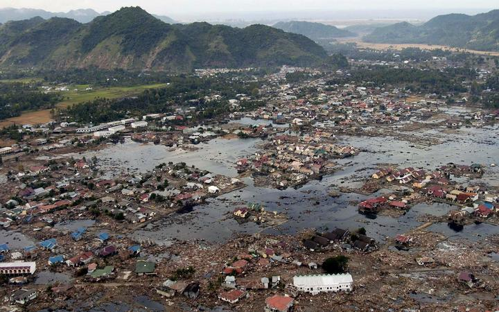 This US Navy handout photo taken 02 January 2005 shows a village along the coast of Sumatra in ruins after an earthquake and tsunami stuck off the coast 26 December.