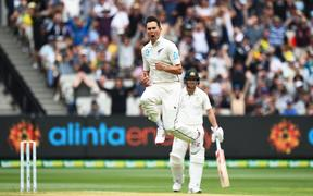 Trent Boult celebrates the wicket of Joe Burns.