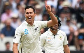 Trent Boult celebrates the wicket of Joe Burns during the 2nd ICC World Test Championship match New Zealand Black Caps v Australia. Melbourne Cricket Ground, Melbourne, Australia. Thursday 26 December 2019. ©Copyright Photo: Chris Symes / www.photosport.nz
