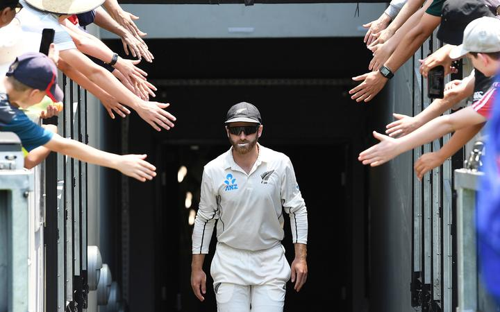 Kane Williamson walks out onto the MCG.