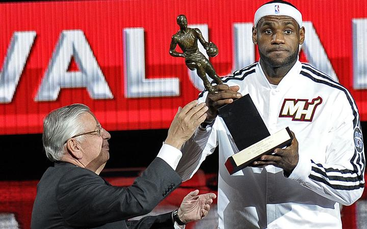 David Stern presents LeBron James with the NBA's MVP award in 2013.