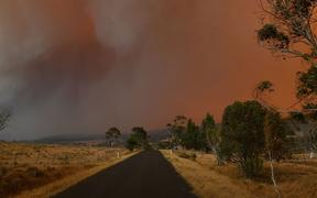 Ember and thick smoke from bushfires reach Braemar Bay in New South Wales on January 4, 2020.