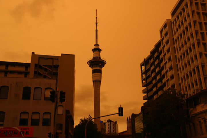 Auckland's Sky Tower in the foreground of a hazy sky from Australia's bushfires.