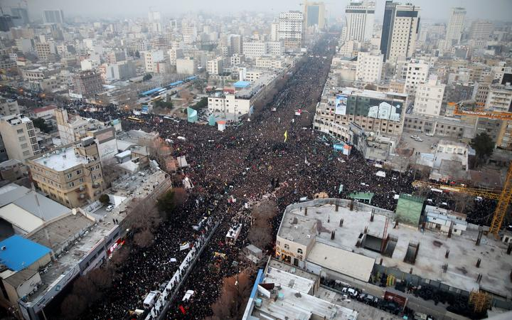 Iranians march behind a vehicle carrying the coffins of slain major general Qassem Soleimani and others as they pay homage in the northeastern city of Mashhad